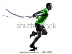 one  man young sprinter runner running winner at finish line in silhouette studio on white background - stock photo