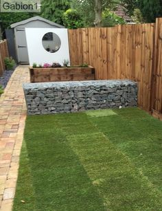 small gabion wall with screen hides garden shed from view. http://www.gabion1.co.uk
