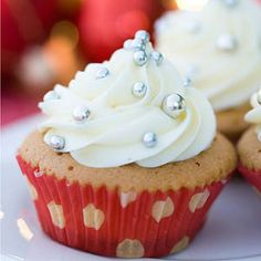 Spices and molasses give these moist cupcakes old-fashioned flavor. Top them with Vanilla Cream Cheese Frosting.