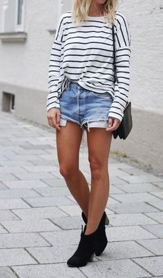 Striped shirt + denim cut off shorts outfit.