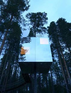 Tree Hotel by Tham and Videgard Arkitekter is accessed by rope bridge and reflects the surrounding forest and sky