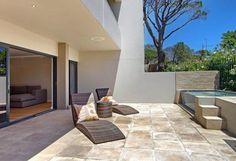 Casablanca - Downstairs patio with plunge pool and sun lounger chars - Nox Rentals Cape Town holiday rental apartment