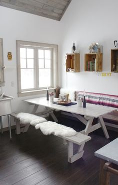 Dining area with a picnic table indoors