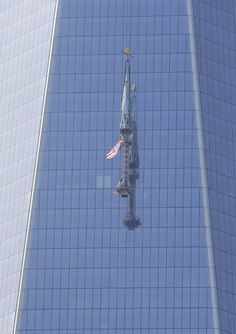 NY ~ The top piece of the 408-foot spire for One World Trade Center is lifted to the top of the building in New York, Thursday, May 2, 2013. When its fully installed, at a later date, it will top the building at a symbolic 1,776 feet.