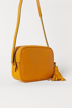 Shoulder bag in grained imitation leather with a decorative tassel in genuine suede. Narrow, adjustable shoulder strap, zip at top and an inner compartment Camera Bag Purse, Crossbody Bag, Cute Purses, Purses And Bags, Leather Bag Pattern, Disney Shoes, Leather Bags Handmade, Handmade Bags, Cute Backpacks