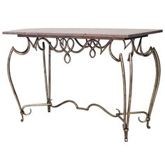 Attributed to the French designer Rene Prou, this gold-painted iron center table features a beige rectangular marble top as well as a scrolling apron and legs joined by a stretcher. Wrought Iron Console Table, Console Tables, Center Table Living Room, Gold Paint, Marble Top, 1940s, Entryway Tables, Modern, Painting