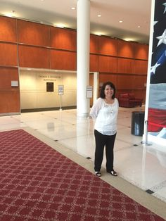 EMPSA Program Assistant, Linda, getting ready to welcome students to Residency Week 2016! — at Annenberg Presidential Conference Center.