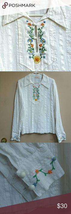 "Vtg.Embroidered Floral Top Hippie Boho Folk Tunic 1970s handmade and embroidered women's top tunic. Looks unworn. Looks like 100% cotton off- white shirt, hand embroidered with floral motif on front and cuffs; it has round buttons and side slits. Has a handmade tag with "" Made Especially for you by Mary Paitich"" Festival, Hippie, boho, folk shirt. Measures: 19.5"" pit to pit,  18"" across shoulders, 24"" length from shoulder. Vintage Tops"