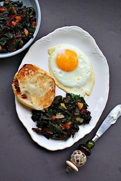 Sautéed greens flavorful with Moroccan spices and a fried egg.  Wonderful little breakfast.