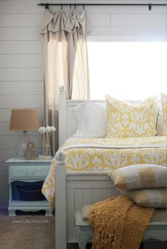 A beautiful and bright summer bedroom with Crane and Canopy Montgomery yellow duvet.: