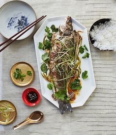 Photograph of Andrew Wong's steamed sea bass with ginger and spring onion