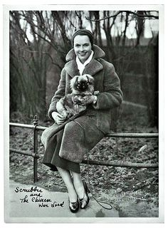 Louise Brooks at the 59th Street entrance to Central Park, NYC with her Pekingese dog Tiki. 1931.