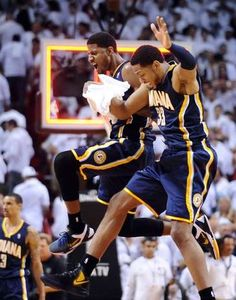 May 15, 2012; Miami, FL, USA; Indiana Pacers shooting guard Paul George (left) and small forward Danny Granger (right) celebrate their 78-85 win over the Miami Heat in game two of the Eastern Conference semifinals of the 2012 NBA Playoffs at American Airlines Arena. Mandatory Credit: Steve Mitchell-US PRESSWIRE