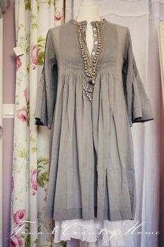 TOWN COUNTRY HOME...love the pop of lace at the bottom and the necklace framing the unbuttoned buttons.