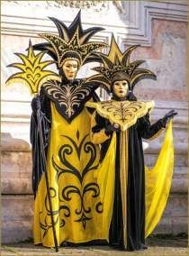 Dramatic black and yellow costumes at Carnival of Venice