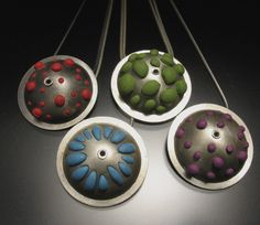 Colorful polymer clay peeks through darkened silver making a fun and bumpy handmade pendant!