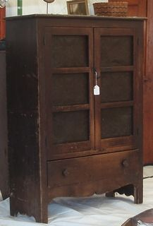 Tara always hopes to find fabulous old wood cabinets like this in the novel Shabby Chic at Heart