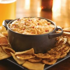 "Buffalo chicken dip: we first tried this amazing ap. at our neighbors and loved it. Everyone who tried it raved about it - and then made it themselves at home. My initial comments on this dish still stand - ""WARNING - approach this dip with a friend, 'cos once you start tasting, it is VERY difficult to stop, and you will need to be dragged away......"" I would say that it tastes even more delicious with rotisserie chicken, as my friend Wendy Curry makes it."