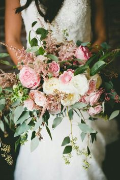 Exquisite Crescent Style Bridal Bouquet Which Features: Pink Cabbage Roses, Pink English Garden & Garden Roses, Ivory English Garden Roses, White Ranunculus, Pink Astilbe, Green Seeded Eucalyptus, & Additional Greenery/Foliage^^^^
