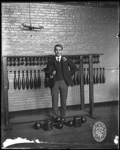 Why don't current gyms have juggling pins as standard fare?    Man in gymnasium  1900  Photograph by James H. Lewis (1881-1960)  4 x 5 inch glass negative  James H. Lewis Collection, 1890-1925  Maryland Historical Society  PP224 001 4-5 029