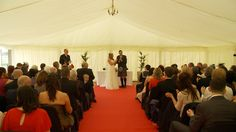 Lauren & Andy Smith within the Club Marquee saying I Do!