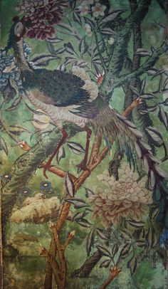 Phoenix (fenghuang) in the Chinese wallpaper in the State Bedroom at Erddig. The bird was cut out and moved (to allow for a chimneypiece), which accounts for its slightly awkward position on the peony branches.©National Trust/Andrew Bush