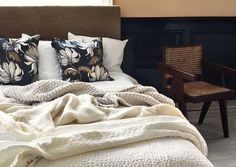 Lots of layers in the bed is essential to survive this cold winter, Calm colours in a relaxing environment.