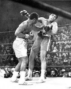 Ali is on the ropes, from a patented Frazier left hook.Smokin Joe Frazier