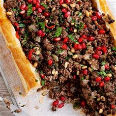 Spicy Lebanese lamb tart recipe. This wonderfully simple lamb tart is excellent topped with a dollop of Greek yogurt. Serve with a fattoush salad.