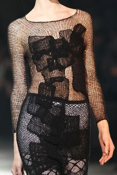 Black crocheted dress with applique patches; fashion detail; textiles for fashion design // Yohji Yamamoto