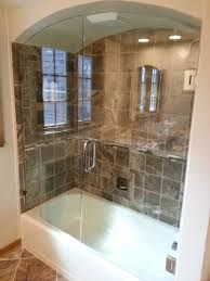 Let our friendly team make over your bathroom with high-quality & affordable, custom glass shower doors, glass tub enclosures, bathtub surround, & more. Tub With Glass Door, Glass Bathtub, Bathtub Shower Doors, Glass Shower Doors, Glass Bathroom, Sliding Glass Door, Glass Doors, Tile Bathrooms, Bath Tub