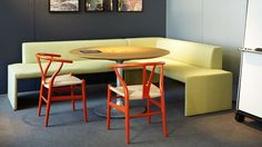 Together Bench and Wishbone chairs create a collaborative setting for the office