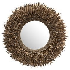 Wall mirror with a metal and coconut shell frame.