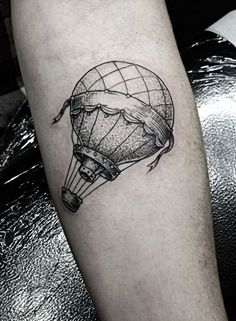 What does hot air balloon tattoo mean? We have hot air balloon tattoo ideas, designs, symbolism and we explain the meaning behind the tattoo.