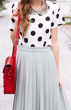 As we all know everything comes back into fashion eventualy, only modified slighty. Like this cute pleated powder blue skirt, and polka dot top with peter pan collar.