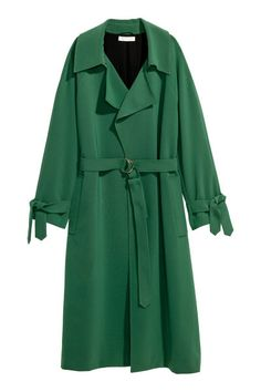 Check this out! Coat in woven fabric with a shawl collar, hook-and-eye fastener at top, and raglan sleeves with attached ties at cuffs. Loose yoke at back, welt side pockets, and vent at back. Soft, removable belt with metal D-rings. Lined. - Visit hm.com to see more.
