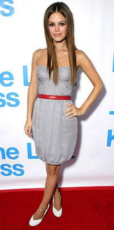 Look of the Day › August 8, 2006 Rachel Bilson looked kissable in a bubble dress by Brian Reyes accented with a lipstick-red belt and a pair of vintage pumps. The actress was attending a listening party for the soundtrack to her upcoming movie, The Last Kiss.