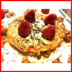 Strawberry, walnuts, coconut flakes,  chia seeds and organic maple syrup on top of a delicious pancake.  Paleo, gluten, dairy and sugar free.  I look forward to this every morning.  #breakfast #pancake #glutenfree #dairyfree #naturalfood #freshingredients