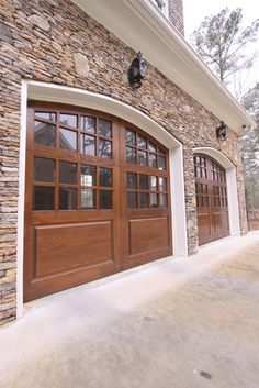 Elegant Beautiful Stacked Stone Exterior And These Gorgeous Garage Doors