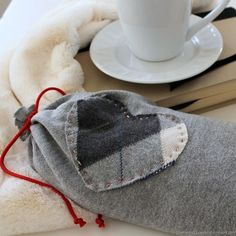 Keep the ones you love cozy this winter by making them their very own Upcycled Sweater Sleeve Heating Pads. Homemade Heating Pad, Diy Heating Pad, Heating Pads, Old Sweater, Upcycled Sweater, Sweaters, Upcycled Crafts, Sewing Crafts, Sewing Projects