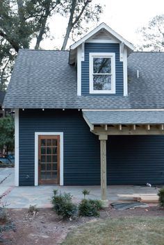 Dark Gray Blue Exterior House Siding- 1/2 Witching Hour & 1/2 Soot by Sherwin Williams  Trim- Dove Wing by Sherwin Williams  Door Stain- Clear Polyurethane
