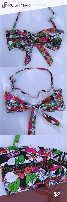 Leilani Bikini Bandou Top Size 14 This bandou top is a white floral top with hot pink and orange flowers green and black. It has a braided detail on the front with a leopard print. Perfect to match with almost any color bottom. Has openings for pads, but they are not included. leilani Swim One Pieces