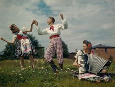 1944 - Members of the Women's Auxiliary Air Force dancing Polish National dances in traditional costume, being taught by Polish airman at a RAF base in Lincolnshire, England during World War Two in August 1944. (Photo by Popperfoto/Getty Images)