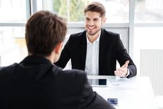 Two cheerful young businessmen using tablet and working together on business meeting in office Self Development, Personal Development, Question And Answer, This Or That Questions, Child Support, Increase Productivity, Business Meeting, Wealth Management, Top Videos