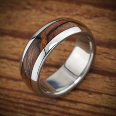 Men's wood wedding ring by Spexton.com, unusual wood and titanium ring that is waterproof and custom made to order.