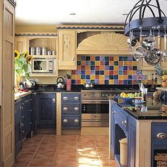 Kitchen-different color tile backsplash behind stove, LOVE it! colored cabinets and the back splash <3