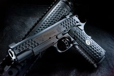 Knighthawk 1911    A custom 1911 jointly designed and made by Nighthawk Tactical and Knights Armament. It looks kind of like a golf ball with all those dimples on it. These were a limited edition production run paired with a Knights Armament AR.