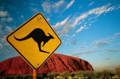 Ayers Rock (Uluru) and a kangaroo crossing sign equal the Outback