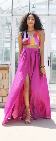 """Catch the breeze in the bright high waist magenta Sahara Maxi Skirt.  The softly gathered waist gives way to a sensual center front split.  Hidden side pockets gives ultimate freedom for impromptu walks in the park or on the beach.  Length  Standard:  44.5"""" / 113.03 cm Tall:  49.5"""" / 125.73 cm  #pink #fuchsia"""