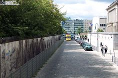 Berlin Germany. A few segments of the 40 mile wall are still up and preserved after 20 years. I think the wall is made of chewing gum, there's so much of it plastered on it.